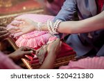 hands of thai couple  in the... | Shutterstock . vector #520421380