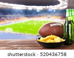 beer with snack and ball on... | Shutterstock . vector #520436758
