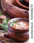 Small photo of Shchi - soup made of sauerkraut, meat and tomato, old wooden background, selective focus