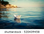 paper ship floating in the sea. ... | Shutterstock . vector #520439458