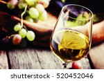 white wine in a glass with fall ... | Shutterstock . vector #520452046