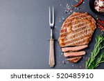 grilled sliced beef steak on... | Shutterstock . vector #520485910