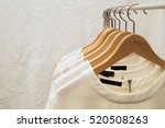 Stock photo ladies blouses and shirts on wooden hangers fashion background 520508263
