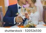 wedding glasses in hands of the ... | Shutterstock . vector #520526530