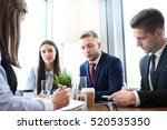 Business People Working On New...
