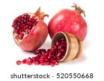 two pomegranate isolated on a... | Shutterstock . vector #520550668