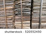 Stacked Wood Against Rods In...