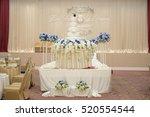 white wedding cake with flower | Shutterstock . vector #520554544