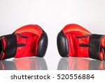 red and black boxing gloves on...   Shutterstock . vector #520556884
