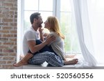 loving adult couple hugging in... | Shutterstock . vector #520560556