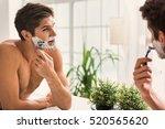 confident guy using shaver in...   Shutterstock . vector #520565620