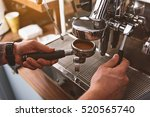 barman attaching portafilter to ... | Shutterstock . vector #520565740