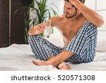 sad guy suffering from hangover ... | Shutterstock . vector #520571308