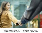 young woman holding man by hand ... | Shutterstock . vector #520573996