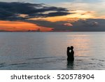 couple kissing on the beach... | Shutterstock . vector #520578904