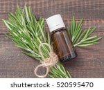 Rosemary Essential Oil In Dark...