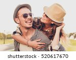 happy couple in love at sunset... | Shutterstock . vector #520617670