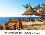 beach at the luxury hotel ... | Shutterstock . vector #520627123