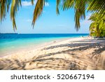 sandy beach in the maldives on... | Shutterstock . vector #520667194
