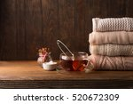 stack of cozy knitted sweaters  ... | Shutterstock . vector #520672309
