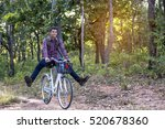 a young man riding a bike in... | Shutterstock . vector #520678360