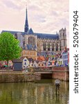 Small photo of Amiens Cathedral of Notre Dame and traditional houses on La place du Don Street at the embankment of Somme canal, Picardy, France. People on the background