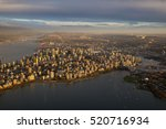 Stock photo aerial cityscape view of downtown vancouver bc canada taken during a cloudy sunset 520716934