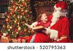 Happy Child Girl Hugging Santa...