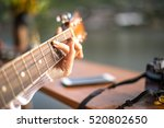 Woman's Hands Playing Acoustic...