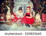 two little girls sitting on a...   Shutterstock . vector #520825660