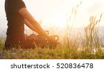 Stock photo hand of a woman meditating in a yoga pose on the beach 520836478