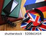 headphones and flag on a wooden ... | Shutterstock . vector #520861414