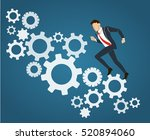 businessman running with gears... | Shutterstock .eps vector #520894060
