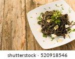squid ink pasta  italian cuisine | Shutterstock . vector #520918546