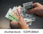 man hand with euro isolated on... | Shutterstock . vector #520918864