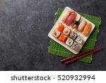 set of sushi and maki roll on... | Shutterstock . vector #520932994