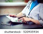 woman doctor using tablet... | Shutterstock . vector #520935934