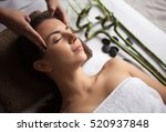 face massage. close up of a... | Shutterstock . vector #520937848