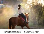 Small photo of Young pretty girl riding a horse
