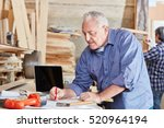 senior craftsman drawing a plan ... | Shutterstock . vector #520964194