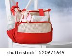 mothers bag with toy and... | Shutterstock . vector #520971649