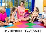 attentive kids sitting around... | Shutterstock . vector #520973254