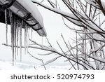 icicles on a house roof. cold... | Shutterstock . vector #520974793