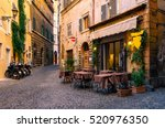 view of old cozy street in rome ...