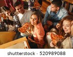 group of young friends eating... | Shutterstock . vector #520989088