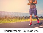 handsome man running on road... | Shutterstock . vector #521005993