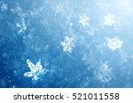 macro shot from snowflake.... | Shutterstock . vector #521011558