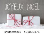 two gifts with snow  joyeux... | Shutterstock . vector #521030578