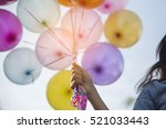 Birthday Balloon Holding By...