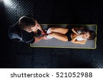 woman doing abdominal crunches... | Shutterstock . vector #521052988